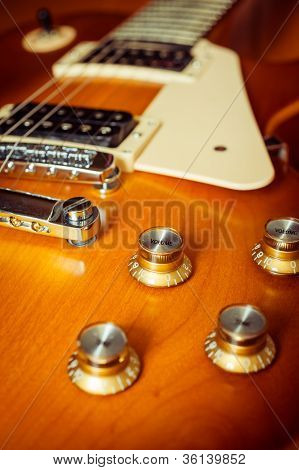 Knob Control Of Electric Guitar On Floor