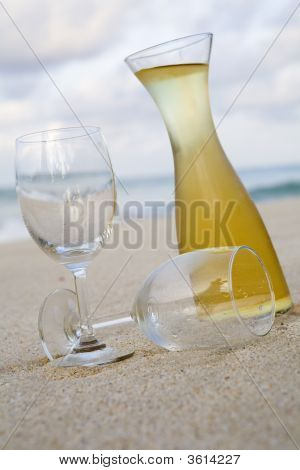 White Wine And Glasses On Beach