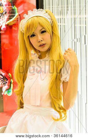 Bangkok - August 26 : An Unidentified Japanese Anime Cosplay Pose In Japan Festa In Bangkok 2012.