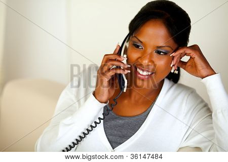 Afro-american Female Conversing On Phone