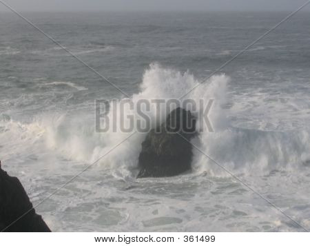 Wave Crashing On Rock