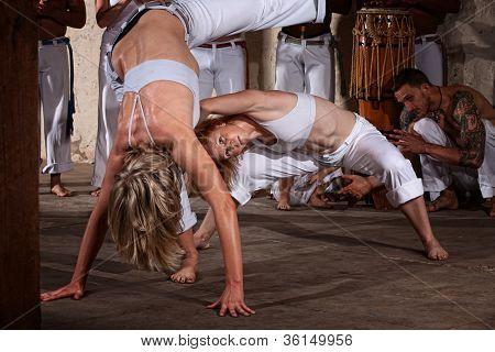 Woman Dodges Capoeria Kick