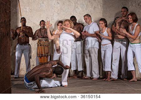 Capoeria Man Dodges Woman's Kick