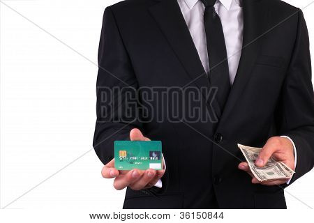 Businessman with credit card and money