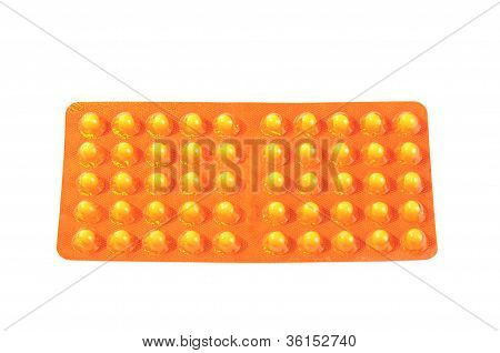 Package with yellow vitamin tablets
