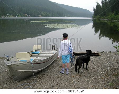 Girl and dog ready to go boating