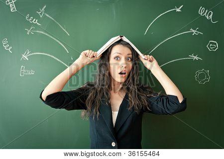 horrified woman over chalkboard