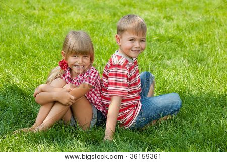 Happy Kids On The Grass