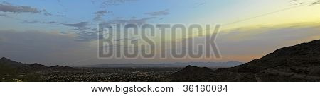 Panorama landscape of the city of Phoenix at sunset.
