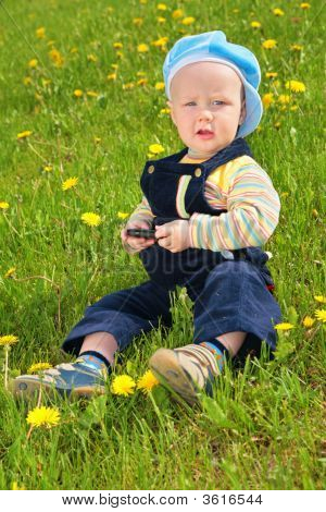 Child Sits On Grass
