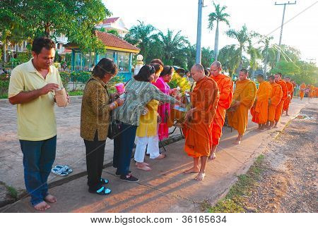 Monks Receiving Rice Offering