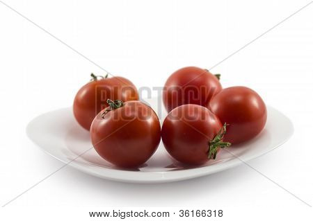 .tomatoes On A Plate