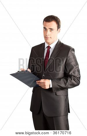businessman writing in clipboard