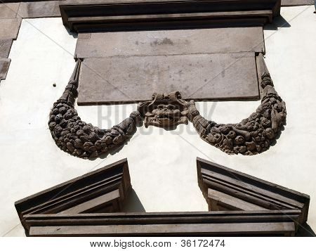 Detail from wall of building - Lucca Tuscany