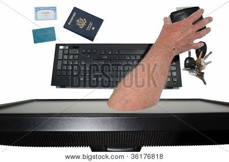 Hand Grabs Wallet From Inside Monitor