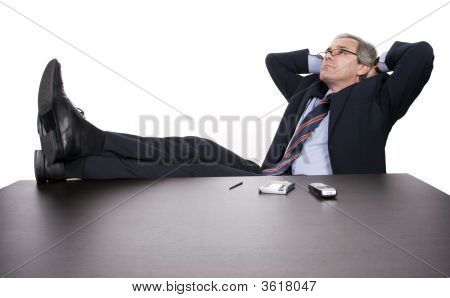 Successful Businessman Relaxing Over His Desk