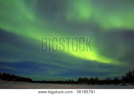 Northern Lights (aurora Borealis) Over Snowscape.
