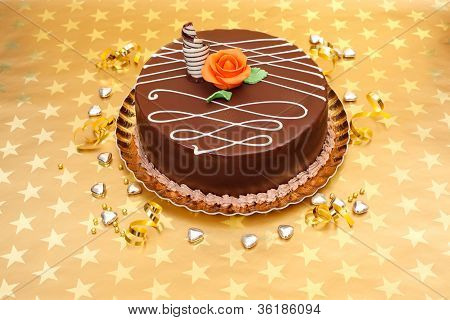 Chocolate Cake On Golden Stars Background