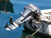 stock photo of outboard engine  - outboard engine on the plastic boat on the sea - JPG
