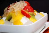 image of pamelo  - Mixed fruits on shaved ice dessert (Pamelo, strawberry, mango, kiwi, watermelon and nata de coco)