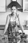 Young Asian Housewife On Domestic Kitchen poster