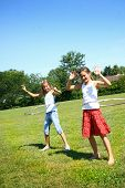 picture of hulahoop  - Two young preteens having fun in a park with hula hoop - JPG