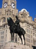 Statue In Front Of The Liver Buildings poster
