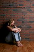 stock photo of mental_health  - woman sitting alone depicting mental health concept of depression - JPG