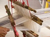picture of loom  - Working on weaving apparatus or loom by Thai people - JPG