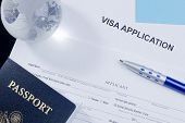 stock photo of citizenship  - Directly above photograph of an application for a visa.
