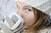foto of hot-chocolate  - Teenage girl in winter hat with cup of hot chocolate - JPG