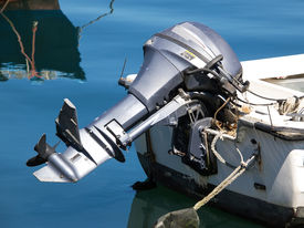 image of outboard engine  - outboard engine on the plastic boat on the sea - JPG