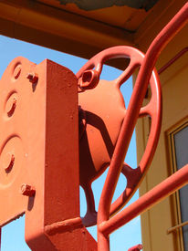 picture of caboose  - This red brake is located on a train caboose in a public park - JPG