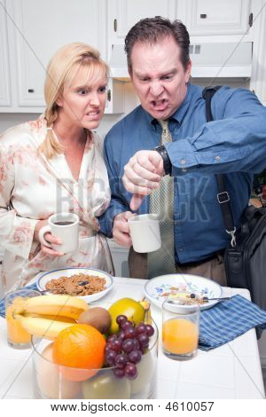 Rushed Couple In Kitchen Late For Work