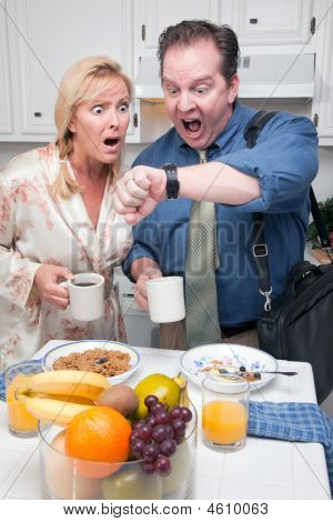 Couple In Kitchen Late For Work