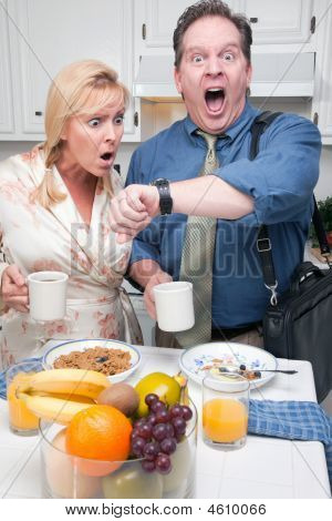 Stressed Couple In Kitchen Late For Work