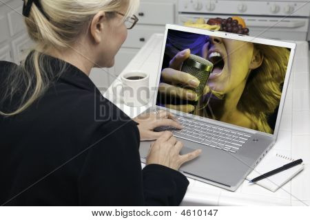 Woman In Kitchen Using Laptop - Entertainment