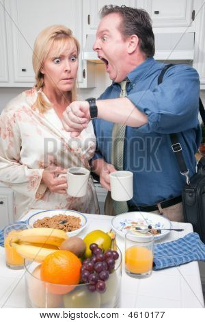 Stunned Couple In Kitchen Late For Work