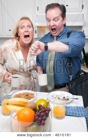 Panicking Couple In Kitchen Late For Work