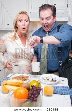 Late For Work - Stressed Couple In Kitchen