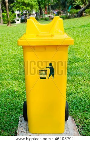 Yellow Refuse Bin In Park