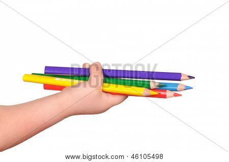 Children's hand holds the colorful pencils. isolated