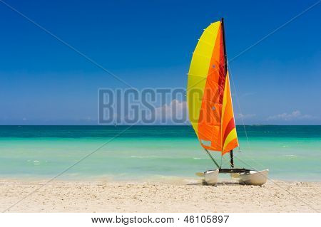 Colorful catamaran on the white sands of Varadero beach in Cuba