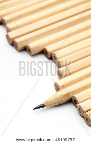 Row of unused pencil with one sharpened