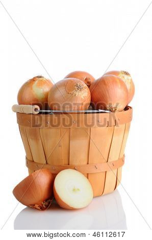 Closeup of brown onions in a bushel basket, isolated on white with reflection.