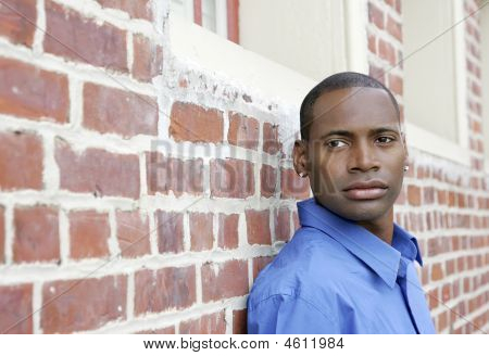 Guy Against Brick Wall