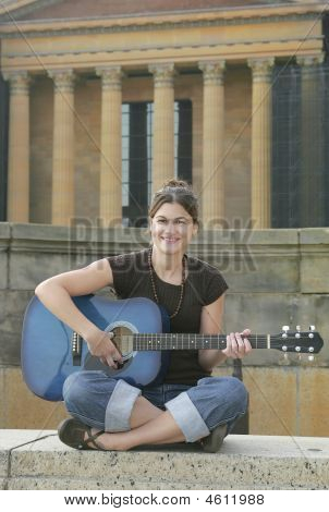 Woman Guitarist Playing