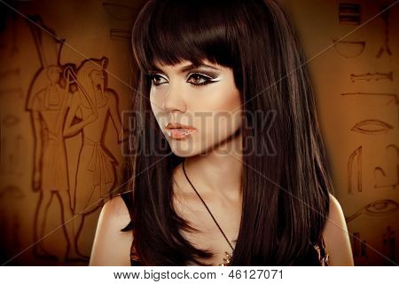 Hair. Beautiful Brunette Girl Over Egyptian Hieroglyphs