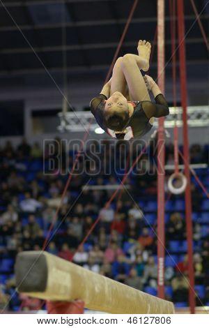 KIEV, UKRAINE - MARCH 31: Noda Sakura, Japan performs routine on balance beam during International Tournament in Artistic Gymnastics Stella Zakharova Cup in Kiev, Ukraine on March 31, 2013