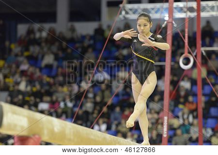 KIEV, UKRAINE - MARCH 31: Minobe Yu, Japan performs routine on balance beam during International Tournament in Artistic Gymnastics Stella Zakharova Cup in Kiev, Ukraine on March 31, 2013
